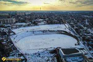 Abandoned stadium with view on Kharkiv